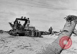 Image of amphibious invasion Pacific Theater, 1944, second 6 stock footage video 65675053522