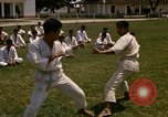 Image of karate class South Vietnam, 1967, second 9 stock footage video 65675053591