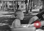Image of bathing an infant Greenbelt Maryland USA, 1939, second 3 stock footage video 65675053713