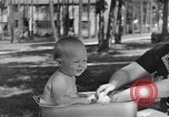 Image of bathing an infant Greenbelt Maryland USA, 1939, second 5 stock footage video 65675053713