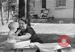 Image of bathing an infant Greenbelt Maryland USA, 1939, second 8 stock footage video 65675053713
