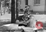 Image of bathing an infant Greenbelt Maryland USA, 1939, second 11 stock footage video 65675053713