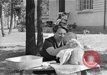 Image of bathing an infant Greenbelt Maryland USA, 1939, second 12 stock footage video 65675053713