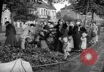 Image of Women pick up abandoned flowers London England United Kingdom, 1938, second 4 stock footage video 65675053799