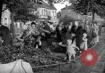 Image of Women pick up abandoned flowers London England United Kingdom, 1938, second 5 stock footage video 65675053799