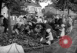 Image of Women pick up abandoned flowers London England United Kingdom, 1938, second 6 stock footage video 65675053799