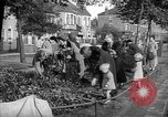 Image of Women pick up abandoned flowers London England United Kingdom, 1938, second 7 stock footage video 65675053799