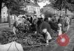 Image of Women pick up abandoned flowers London England United Kingdom, 1938, second 8 stock footage video 65675053799