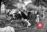 Image of Women pick up abandoned flowers London England United Kingdom, 1938, second 10 stock footage video 65675053799