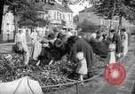 Image of Women pick up abandoned flowers London England United Kingdom, 1938, second 12 stock footage video 65675053799
