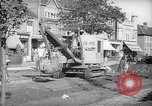 Image of steam shovel and heavy timbers at construction site London England United Kingdom, 1938, second 10 stock footage video 65675053800