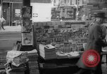 Image of newspaper stalls New York City USA, 1940, second 10 stock footage video 65675054141