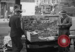 Image of newspaper stalls New York City USA, 1940, second 12 stock footage video 65675054141