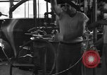 Image of manufacturing plant United States USA, 1942, second 7 stock footage video 65675054248