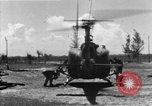 Image of U.S. Marine Corps UH-1E Huey gunship and  A-4 jet attack target Da Nang Vietnam, 1967, second 2 stock footage video 65675054269