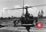 Image of U.S. Marine Corps UH-1E Huey gunship and  A-4 jet attack target Da Nang Vietnam, 1967, second 3 stock footage video 65675054269