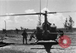 Image of U.S. Marine Corps UH-1E Huey gunship and  A-4 jet attack target Da Nang Vietnam, 1967, second 4 stock footage video 65675054269