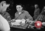 Image of Italian prisoners of war in mess line on USS Wasp (CV-18) Atlantic Ocean, 1945, second 9 stock footage video 65675054311