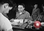 Image of Italian prisoners of war in mess line on USS Wasp (CV-18) Atlantic Ocean, 1945, second 10 stock footage video 65675054311