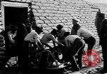 Image of French Marines unload small rail car Syria, 1916, second 7 stock footage video 65675054340