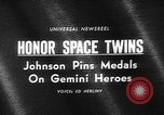 Image of President Johnson awards NASA Gemini IV crew Washington DC USA, 1965, second 4 stock footage video 65675054393
