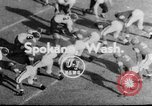 Image of football match Spokane Washington USA, 1953, second 1 stock footage video 65675054576