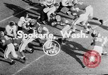 Image of football match Spokane Washington USA, 1953, second 2 stock footage video 65675054576
