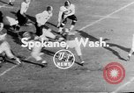 Image of football match Spokane Washington USA, 1953, second 3 stock footage video 65675054576