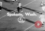 Image of football match Spokane Washington USA, 1953, second 4 stock footage video 65675054576