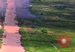 Image of Aerial bombing views of village in Vietnam war Vietnam, 1965, second 1 stock footage video 65675054848