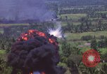 Image of American Skyraider aircraft bombing run Vietnam War Vietnam, 1965, second 10 stock footage video 65675054854