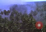 Image of American bombardment of Vietcong target areas Vietnam, 1965, second 8 stock footage video 65675054859