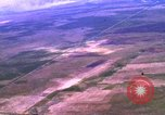 Image of Viet Cong huts bombed Bien Hoa Vietnam, 1965, second 2 stock footage video 65675054876