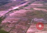 Image of Viet Cong huts bombed Bien Hoa Vietnam, 1965, second 5 stock footage video 65675054876