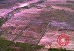 Image of Viet Cong huts bombed Bien Hoa Vietnam, 1965, second 6 stock footage video 65675054876
