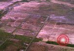 Image of Viet Cong huts bombed Bien Hoa Vietnam, 1965, second 7 stock footage video 65675054876