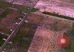 Image of Viet Cong huts bombed Bien Hoa Vietnam, 1965, second 11 stock footage video 65675054876