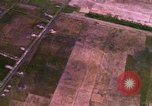 Image of Viet Cong huts bombed Bien Hoa Vietnam, 1965, second 12 stock footage video 65675054876