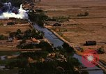 Image of Viet Cong huts bombed Soc Trang Vietnam, 1965, second 9 stock footage video 65675054877