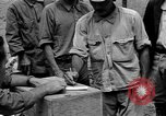 Image of Okinawan workers Okinawa Ryukyu Islands, 1945, second 9 stock footage video 65675054928