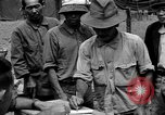 Image of Okinawan workers Okinawa Ryukyu Islands, 1945, second 11 stock footage video 65675054928
