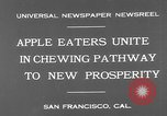 Image of people eat apples to help jobless growers San Francisco California USA, 1931, second 5 stock footage video 65675055145
