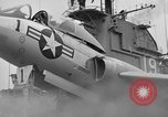 Image of Cockpit of F7U on catapult Pacific Ocean, 1954, second 9 stock footage video 65675055314