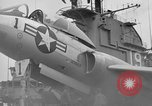 Image of Cockpit of F7U on catapult Pacific Ocean, 1954, second 12 stock footage video 65675055314