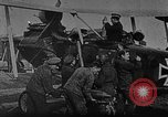 Image of Loading bombs in cockpit of German airplane France, 1917, second 1 stock footage video 65675055374