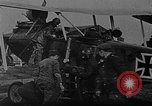 Image of Loading bombs in cockpit of German airplane France, 1917, second 4 stock footage video 65675055374