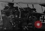 Image of Loading bombs in cockpit of German airplane France, 1917, second 5 stock footage video 65675055374