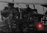 Image of Loading bombs in cockpit of German airplane France, 1917, second 6 stock footage video 65675055374
