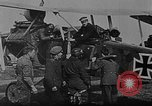 Image of Loading bombs in cockpit of German airplane France, 1917, second 7 stock footage video 65675055374