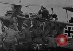 Image of Loading bombs in cockpit of German airplane France, 1917, second 8 stock footage video 65675055374